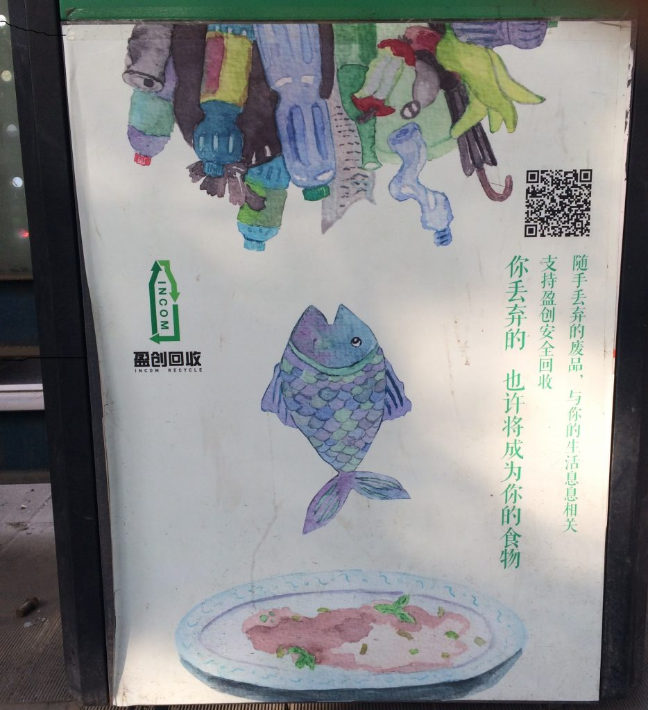"""The things you discard maybe become your food"" is what this Chinese poster in Beijing says."